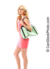 Blond beautie holding a trendy handbag