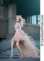Blond beautiful luxury woman in wedding dress