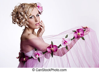 Blond beautiful woman with flowers