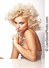 Blond beauty signaling to keep secret
