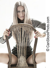 Blond beauty sitting on a chair