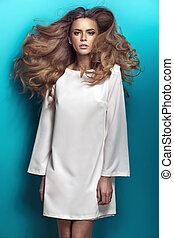Blond beauty wearing white dress