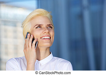 Blond beauty woman smiling and using mobile phone