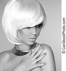 Blond bob hairstyle. Beauty portrait of fashionable girl model p