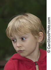Blond boy looks to the left.
