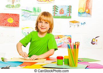 Blond boy on preschool art class - One happy boy on creative...