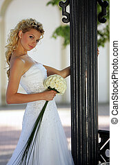 Blond bride with bouquet