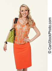 blond business woman in summer orange skirt and blouse