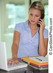 Blond businesswoman at desk