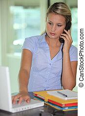 Blond businesswoman at desk