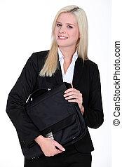 Blond businesswoman holding satchel