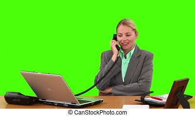 Blond businesswoman in suit having a phone call