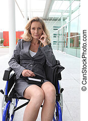 Blond businesswoman in wheelchair