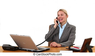 Blond businesswoman laughing on the phone
