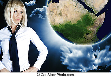 businesswoman looking at globe