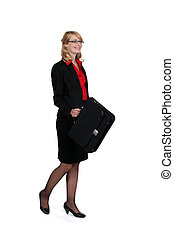 Blond businesswoman posing with briefcase