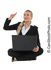 Blond businesswoman raising hand with question