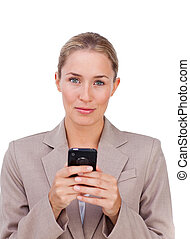 Blond businesswoman sending a text