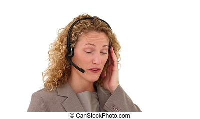 Blond businesswoman talking on the phone