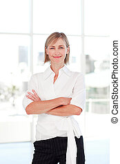 Blond businesswoman with folded arms