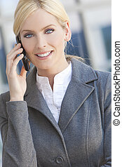 Blond Businesswoman Woman Talking On Her Cell Phone