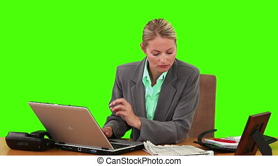 Blond businesswoman working at her desk