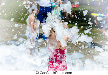 blond child in foam back view