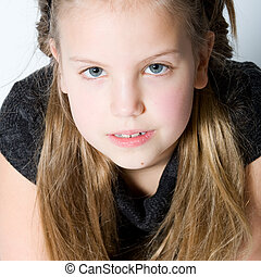 Blond child making eye contact - Studio portrait of a blond ...