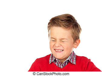Blond child with a funny expression closing his eyes