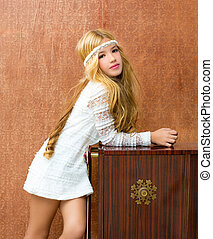 Blond children girl retro 70s with vintage furniture - Blond...