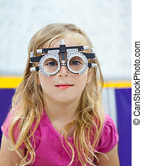 blond children girl with optometrist diopter glasses smiling