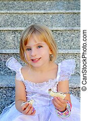 blond children princess girl eating chocolate sandwich