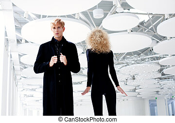Blond couple classic secret agent and sexy girl