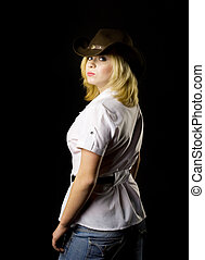 Blond CowGirl - studio shot back view