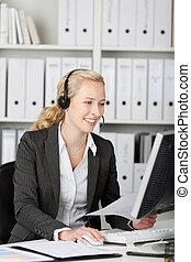 Blond Customer Service Executive Using Headset