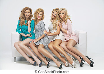 Blond cute ladies on the couch - Blond cute ladies on the ...