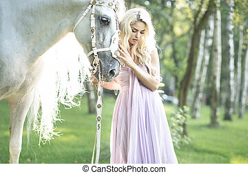 Blond cute woman with a horse