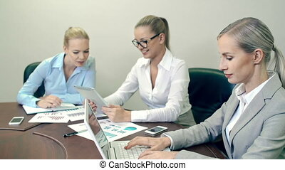 Blond Department Briefing - Three smart ladies at business...