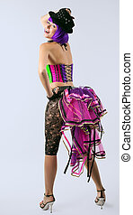 Blond disco girl dance in  color corset