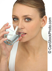 Blond drinking glass of water