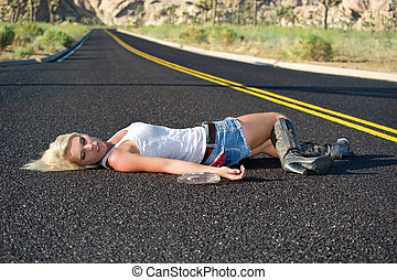 Blond drunk on highway - A young blond woman passed out...
