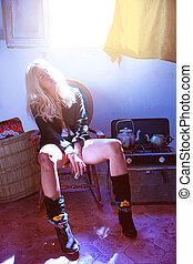 blond fashion girl drinking tea in grunge indoor