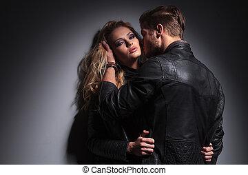 Blond fashion man kissing his lover - Blond fashion man...