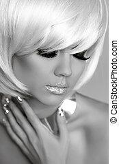 Blond fashion model portrait. Eye makeup. Tempting girl...