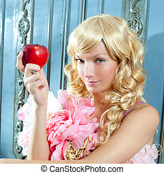 blond fashion princess eating apple with flowers dress