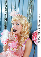 blond fashion princess woman eating chocolate