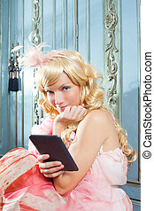 blond fashion princess woman reading ebook tablet