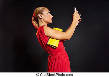 Blond fashion woman selfie photo in smartphone
