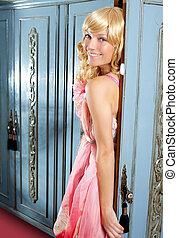 blond fashion woman vintage in wardrobe pink dress