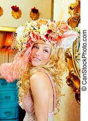 blond fashion woman with spring flowers hat